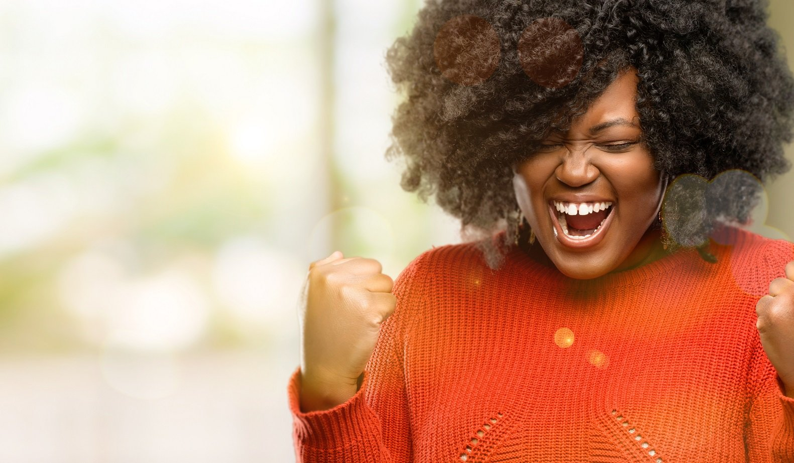 Beautiful african woman happy and excited celebrating victory expressing big success