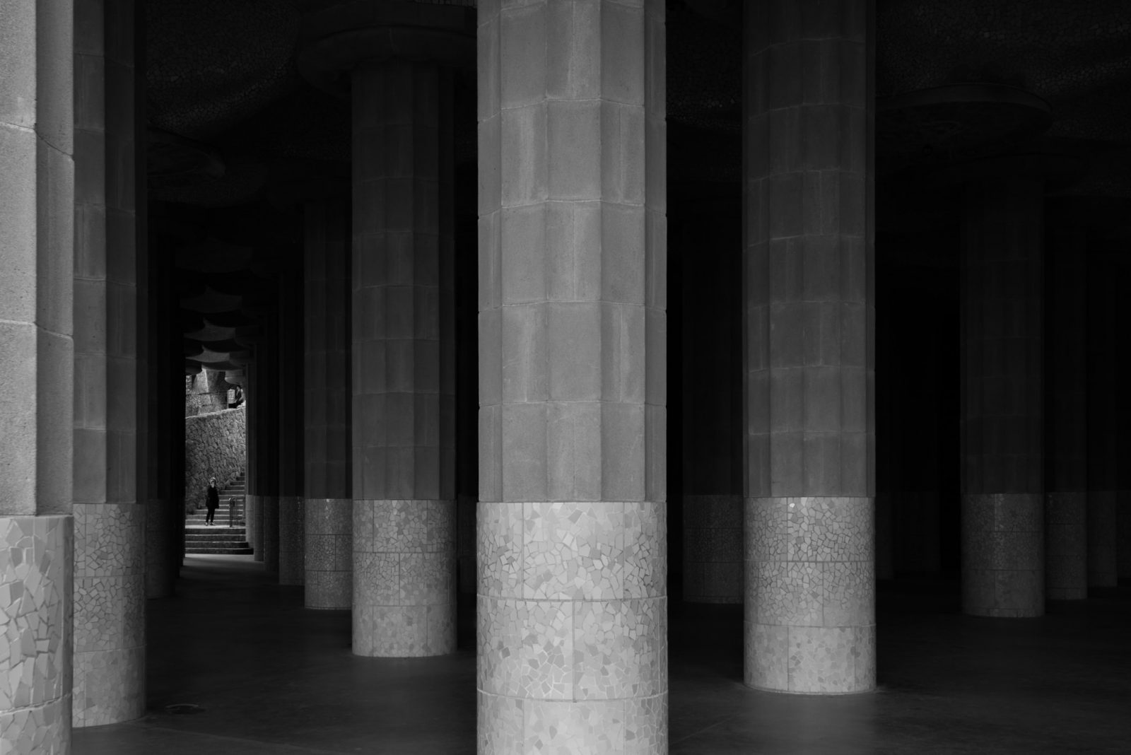 A black and white photo of big pillars.